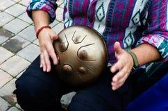 Dream Drum. Street musician playing Dream Drum Stock Image
