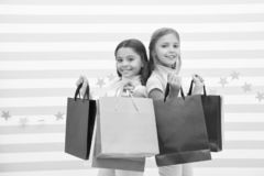 Dream of every girl shopping together with best friend. Girls children best friends hold bunch of shopping bags. Seasonal sale and discount. Possible to buy royalty free stock image