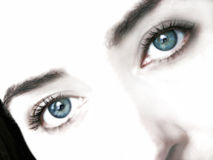 Dream Eyes. Glowing, soft focus with blue-green colored eyes.  Self portrait Royalty Free Stock Images