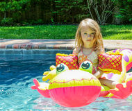 Dream Float. Little Girl Riding a Pool Float Royalty Free Stock Image