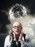 Dream. Funny bald man dreaming of thick hair Stock Photography