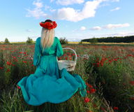 Dream. The girl on a meadow with poppies as in the fairy tale Royalty Free Stock Photography