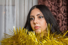Dream girl with tinsel. Brunette girl and Christmas tinsel Royalty Free Stock Images