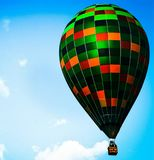 Dream is here just look to the sky. Big and colored balloon in the blue sky royalty free stock photos