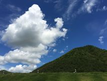 Dream holiday destination, Meadow and mountain view in the blue sky sunny day in southeast Asia. Thailand Royalty Free Stock Images