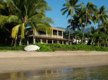Dream Home. View of a private home on a stunning beach Royalty Free Stock Images