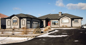 Dream home. A grey stucco luxury home with a double garage Royalty Free Stock Photo