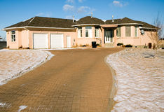 Dream home. Pink upper class luxury home with double garage and brick driveway Royalty Free Stock Images
