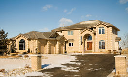 Dream home. Two-story upper class brick luxury home with triple garage Stock Photo