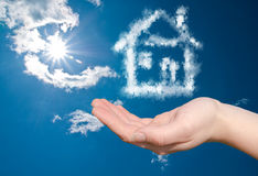 Dream home in the clouds. A dream home in the clouds on a hand Royalty Free Stock Photo
