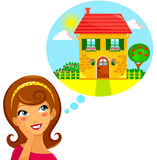 Dream home. Young woman dreaming of a beautiful house Royalty Free Stock Image