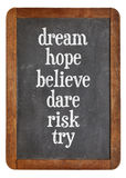Dream, hope, believe, dare, risk try on balckboard Stock Image