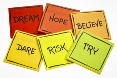 Dream, hope, believe, dare, risk, and try. Dream, hope, believe, dare, risk, try - motivational concept - a set of isolated sticky notes with handwriting royalty free stock photography