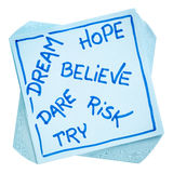 Dream, hope, believe, risk, and try note stock photo