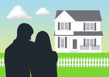 Dream House. Couple looking at their dream house Stock Photo