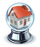 Dream House. In a crystal ball transparent glass sphere and a chrome metal base on a white background with a shadow as a symbol of housing and real estate home Royalty Free Stock Images