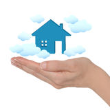 Dream house. Female hand and dream house with clouds on white background royalty free stock images