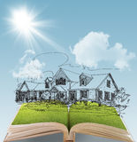 Dream house. Open book of a dream house with sunlight blue sky green grass Stock Photography