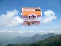 Dream house. In dramatic cloudy mountain - areal view royalty free stock image