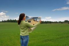 Dream house. Woman dreaming of new home royalty free stock image