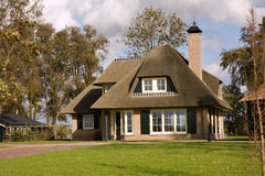 Dream house. Beautiful cottage on green grass. This photo was taken in a small town near the Delft (Netherlands Royalty Free Stock Photo