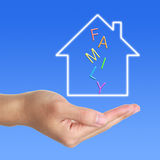 Dream House In Hand. Hand with dream house on blue background. Which can used for the theme of family and so on royalty free stock photography