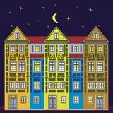Dream house at night. Historical town-house, very elaborate and highly detailed, freaky, colorful and fancy. Could be anywhere in Europe Stock Image