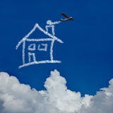 Dream house in the sky. Dream house made of clouds in the sky by a skywriter stock illustration