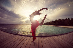 Dream Island. Dancing woman on a jetty Stock Image