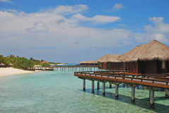 Dream Island Vacation on Overwater Bungalow. Dream Island Holiday with Overwater Bungalow on Blue Turquoise Water just like in Paradise Stock Image