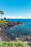 Dream island. Wild tropical beach with rocks and contrast blue sky. Bali island. Indonesia royalty free stock photography