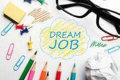 Dream job. Concept with some office supplies around it on white background Royalty Free Stock Photography