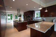 Dream kitchen. With granite countertops and dark wood cabinets Royalty Free Stock Photos