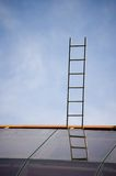 Dream ladder. A ladder on a roof of modern building stock photo