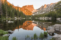 Dream Lake Alpenglow. The first reddish light of alpenglow hits Hallett Peak, reflected in Dream Lake in Rocky Mountain National Park, Colorado Royalty Free Stock Photography