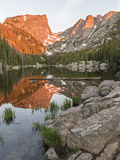 Dream Lake Alpenglow Vertical. The first reddish light of alpenglow hits Hallett Peak, reflected in Dream Lake in Rocky Mountain National Park, Colorado Royalty Free Stock Images