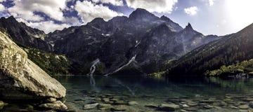 Dream lake in the mountains. The mountain Rysy behind a beautiful lake Morskie oko. Poland - Tatry - Zakopane Royalty Free Stock Photo