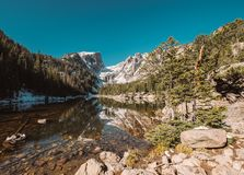 Dream Lake, Rocky Mountains, Colorado, USA. Dream Lake and reflection with mountains in snow around at autumn. Rocky Mountain National Park in Colorado, USA Stock Photo