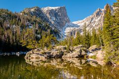 Dream Lake, Rocky Mountains, Colorado, USA. Dream Lake and reflection with mountains in snow around at autumn. Rocky Mountain National Park in Colorado, USA royalty free stock image