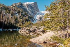 Dream Lake, Rocky Mountains, Colorado, USA. Dream Lake and reflection with mountains in snow around at autumn. Rocky Mountain National Park in Colorado, USA Royalty Free Stock Photo