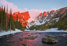 Dream Lake at Sunrise. The peaks glow at sunrise at Dream Lake in Rocky Mountain National Park Stock Photo