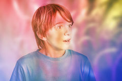 Dream. Little boy surprised in a colorful dream Stock Image
