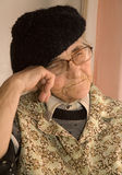 Dream of old woman. In the kitchen - portrait stock images