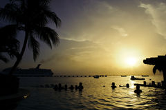 Dream pool in Caribbean resort at dusk. Great holiday shot. Amazing pool next to the ocean at dusk Stock Photo