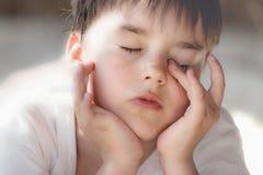 Dream. Portrait of  boy in light tones Stock Images