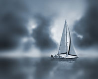 Dream Sail Boat. A sail boat in fog and clouds Stock Images