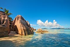 Dream seascape view. With a big stones and palmtree, Seychelles, La Digue island Royalty Free Stock Images