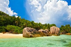 Dream seascape view. With a big stones and palmtree, Seychelles, La Digue island Stock Photos