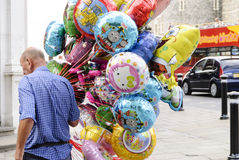 The dream seller. Seller makes you dream of colorful balloons children in a street of Windsor Castle Royalty Free Stock Photography