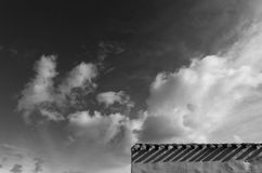 Dream sky. Black and white for this composition with a roof's detail and clouds Stock Photo